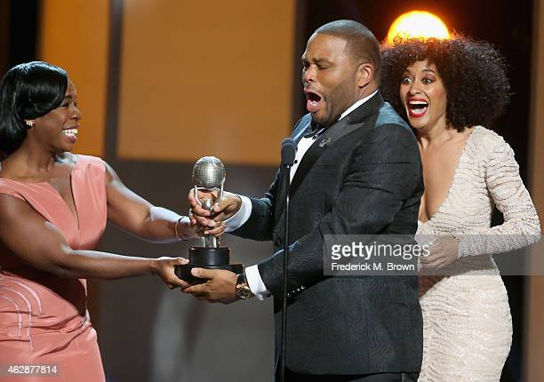 Actresses Uzo Aduba and Tracee Ellis Ross present actor Anthony Anderson with the award for Outstanding Actor in a Comedy Series for 'Blackish'...