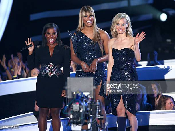 Actresses Uzo Aduba Laverne Cox and Taylor Schilling speak onstage during the 2014 MTV Video Music Awards at The Forum on August 24 2014 in Inglewood...