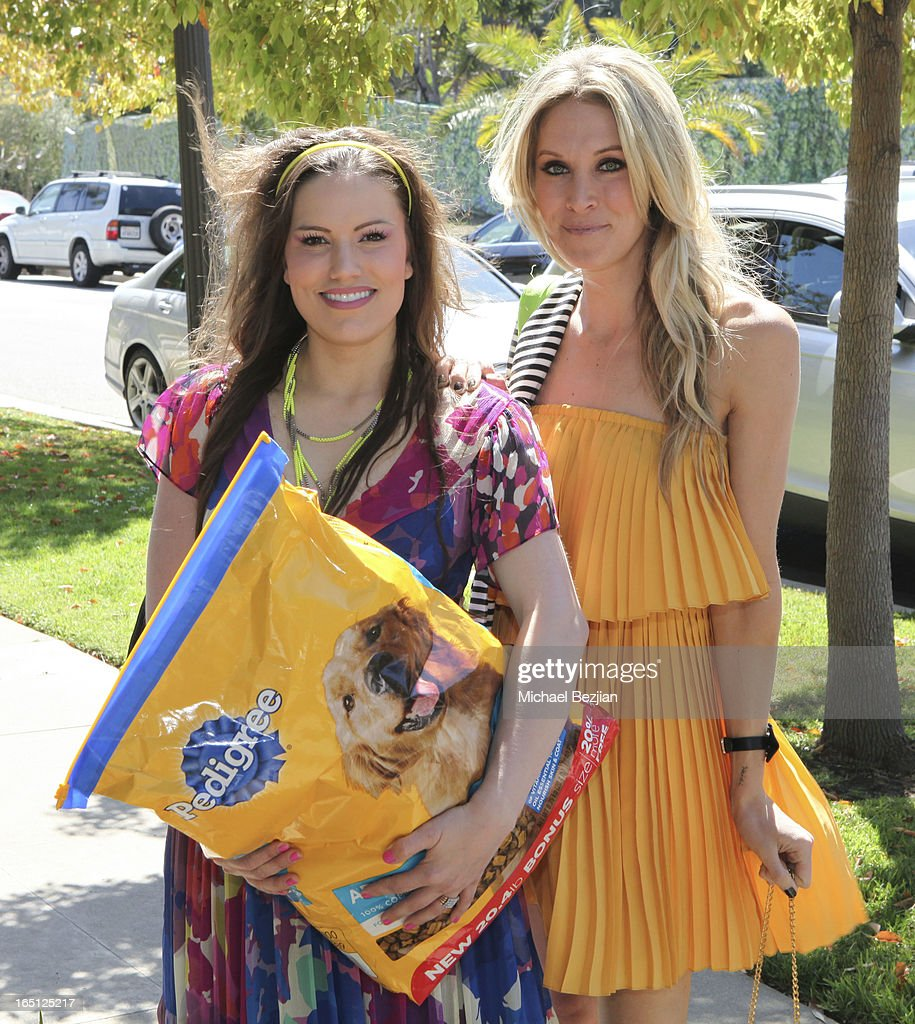 Actresses Vanessa Gomez and Samantha Schacher (R) arrive at Posing Heroes, 'A Dog Day Afternoon' Benefiting A Wish For Animals on March 30, 2013 in Los Angeles, California.