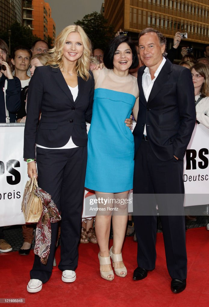 Actresses Veronica Ferres, Jasmin Tabatabai and Nico Hofmann attend the First Steps Award 2011 at the Theater Am Potsdamer Platz on August 23, 2011 in Berlin, Germany.