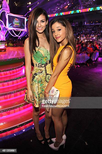 Actresses Victoria Justice and Ariana Grande attend Nickelodeon's 27th Annual Kids' Choice Awards held at USC Galen Center on March 29 2014 in Los...