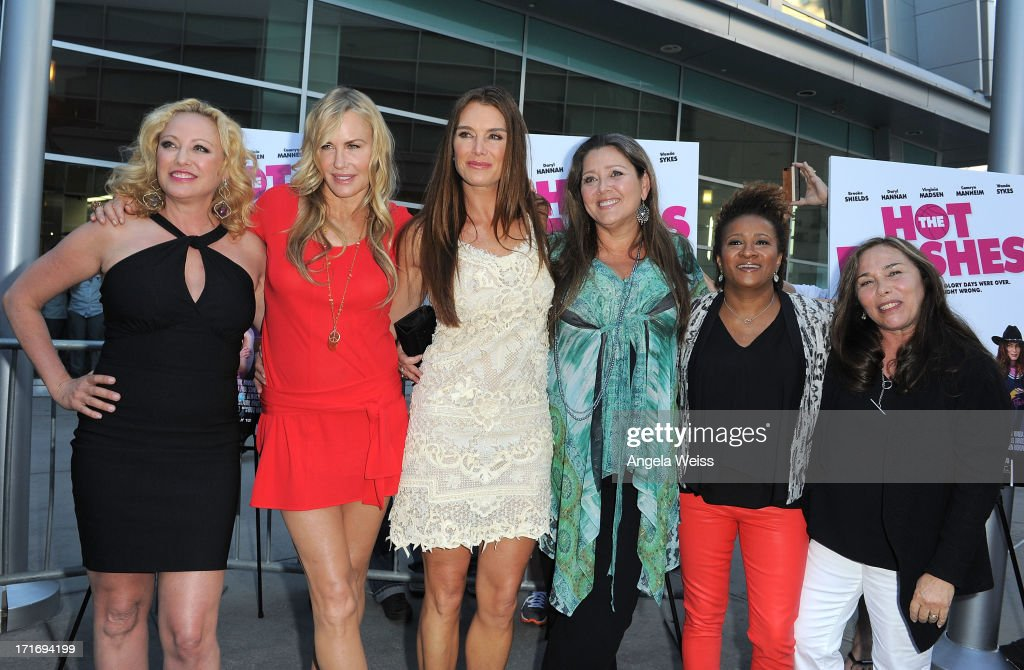 Actresses <a gi-track='captionPersonalityLinkClicked' href=/galleries/search?phrase=Virginia+Madsen&family=editorial&specificpeople=202232 ng-click='$event.stopPropagation()'>Virginia Madsen</a>, <a gi-track='captionPersonalityLinkClicked' href=/galleries/search?phrase=Daryl+Hannah&family=editorial&specificpeople=201860 ng-click='$event.stopPropagation()'>Daryl Hannah</a>, <a gi-track='captionPersonalityLinkClicked' href=/galleries/search?phrase=Brooke+Shields&family=editorial&specificpeople=202197 ng-click='$event.stopPropagation()'>Brooke Shields</a>, <a gi-track='captionPersonalityLinkClicked' href=/galleries/search?phrase=Camryn+Manheim&family=editorial&specificpeople=204200 ng-click='$event.stopPropagation()'>Camryn Manheim</a>, <a gi-track='captionPersonalityLinkClicked' href=/galleries/search?phrase=Wanda+Sykes&family=editorial&specificpeople=208075 ng-click='$event.stopPropagation()'>Wanda Sykes</a> and director <a gi-track='captionPersonalityLinkClicked' href=/galleries/search?phrase=Susan+Seidelman&family=editorial&specificpeople=708685 ng-click='$event.stopPropagation()'>Susan Seidelman</a> arrive at the premiere of 'The Hot Flashes' at ArcLight Cinemas on June 27, 2013 in Hollywood, California.