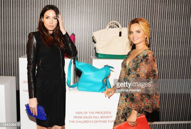 Actresses Whitney Cummings and Mena Suvari attend an evening of cocktails and shopping to benefit the Children's Defense Fund hosted by Coach held at...