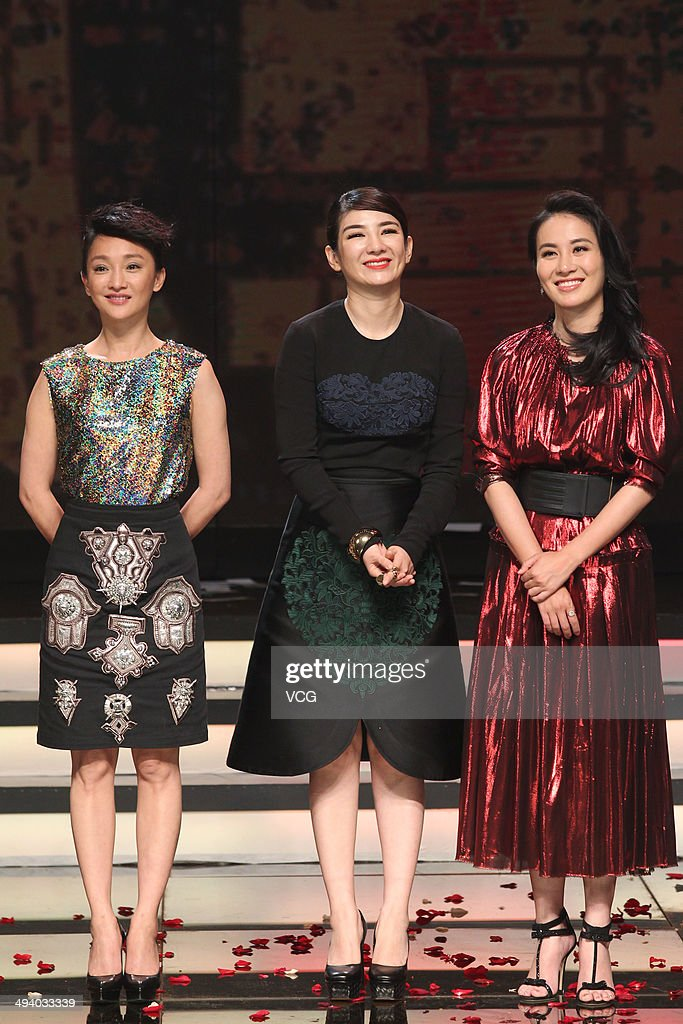 Actresses Zhou Xun, Huang Yi and Michelle Ye attend 'Overheard 3' premiere at Tsinghua University on May 27, 2014 in Beijing, China.