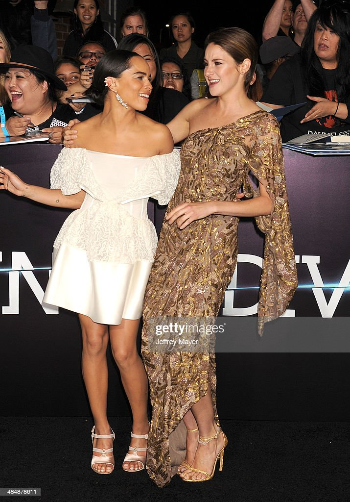 Actresses <a gi-track='captionPersonalityLinkClicked' href=/galleries/search?phrase=Zoe+Kravitz&family=editorial&specificpeople=680250 ng-click='$event.stopPropagation()'>Zoe Kravitz</a> (L) and <a gi-track='captionPersonalityLinkClicked' href=/galleries/search?phrase=Shailene+Woodley&family=editorial&specificpeople=676833 ng-click='$event.stopPropagation()'>Shailene Woodley</a> arrive at the Los Angeles premiere of 'Divergent' at Regency Bruin Theatre on March 18, 2014 in Los Angeles, California.