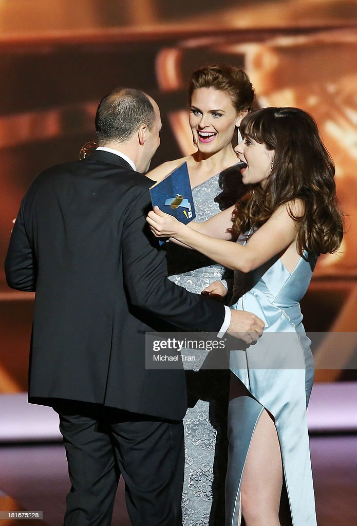 Actresses Zooey Deschanel and Emily Deschanel with Winner for Supporting Actor in a Comedy Series, Tony Hale onstage during the 65th Annual Primetime Emmy Awards held at Nokia Theatre L.A. Live on September 22, 2013 in Los Angeles, California.