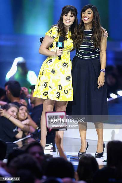 Actresses Zooey Deschanel and Hannah Simone speak onstage at WE Day California 2016 at The Forum on April 7 2016 in Inglewood California