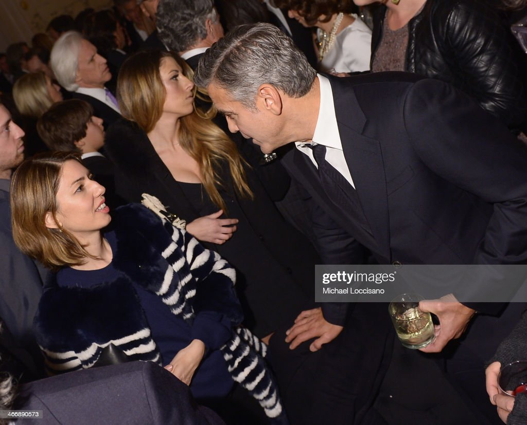 Actress/filmmaker <a gi-track='captionPersonalityLinkClicked' href=/galleries/search?phrase=Sofia+Coppola&family=editorial&specificpeople=202230 ng-click='$event.stopPropagation()'>Sofia Coppola</a> and actor/director/producer <a gi-track='captionPersonalityLinkClicked' href=/galleries/search?phrase=George+Clooney&family=editorial&specificpeople=202529 ng-click='$event.stopPropagation()'>George Clooney</a> attend the after party following the 'Monuments Men' premiere at The Metropolitain Club on February 4, 2014 in New York City.