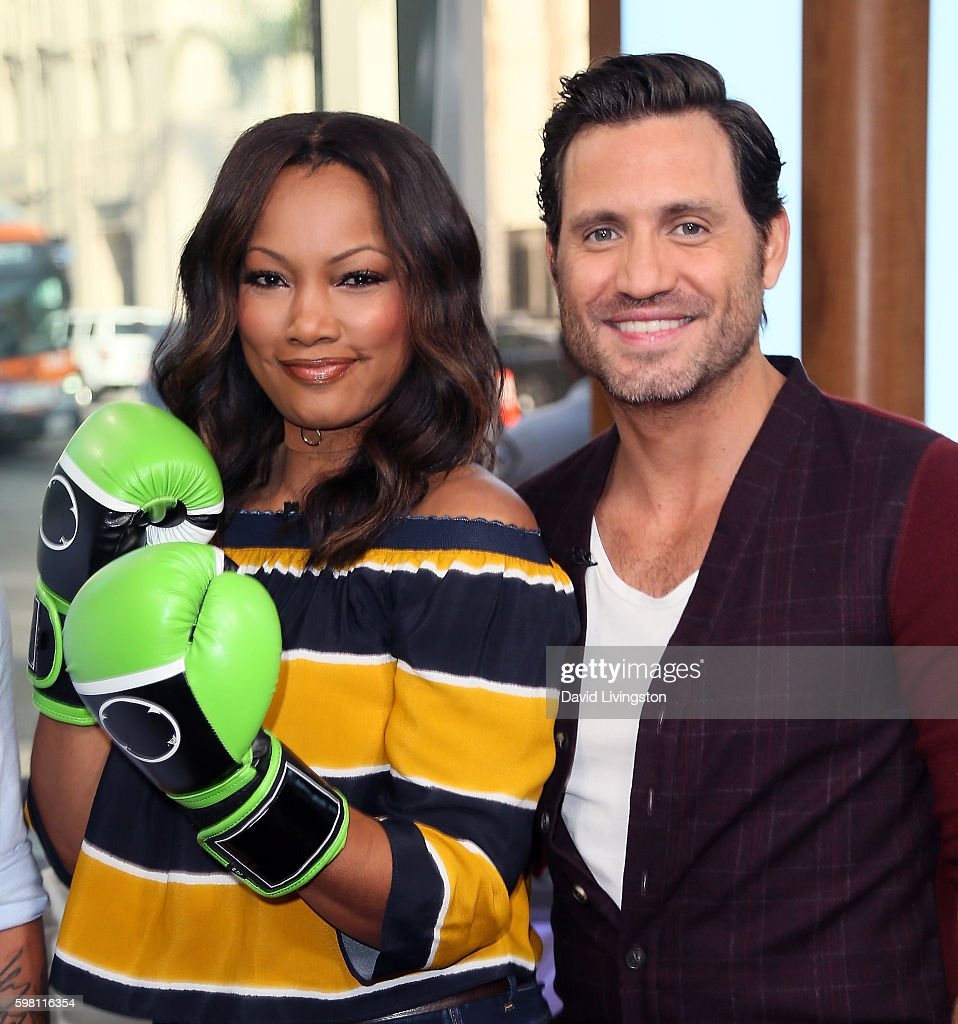 Actress/host Garcelle Beauvais (L) poses with actor Edgar Ramirez at Hollywood Today Live at W Hollywood on August 31, 2016 in Hollywood, California.