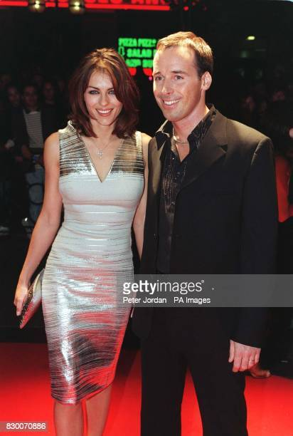 Actress/model Elizabeth Hurley arrives with David Furnish for tonight's ELLE Style Awards at the Sound Republic in London Photo by Peter Jordan/PA