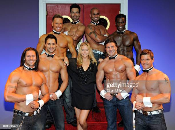 Actress/model Estella Warren poses with Chippendales dancers as she hosts the 'Ultimate Girls Night Out' at the Chippendales show at the Rio Hotel...