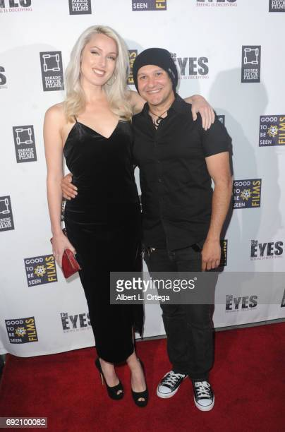 Actress/model Hollin Haley and artist/musician Neil D'Monte arrive for the Premiere Of Parade Deck Films' 'The Eyes' held at Arena Cinelounge on...
