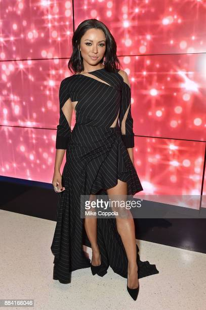 Actress/model Kat Graham poses for a picture at the 2017 amfAR generationCURE Holiday Party on December 1 2017 in New York City