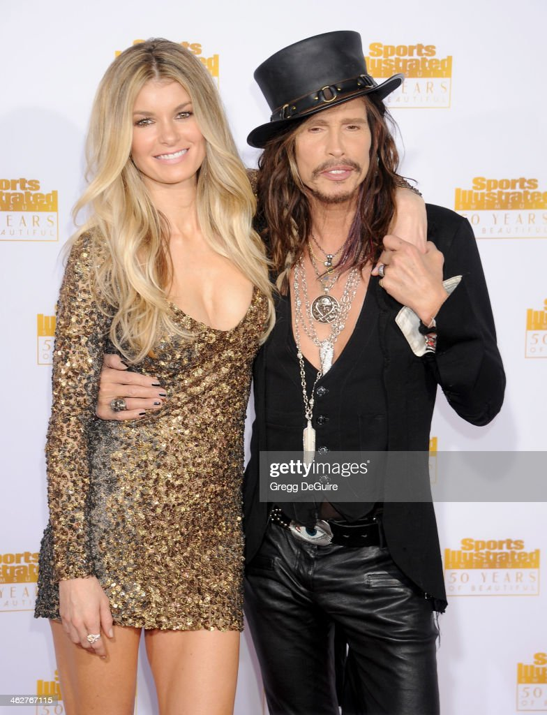 Actress/model Marisa Miller and singer Steven Tyler of Aerosmith arrive at the 50th Anniversary Celebration Of Sports Illustrated Swimsuit Issue at Dolby Theatre on January 14, 2014 in Hollywood, California.