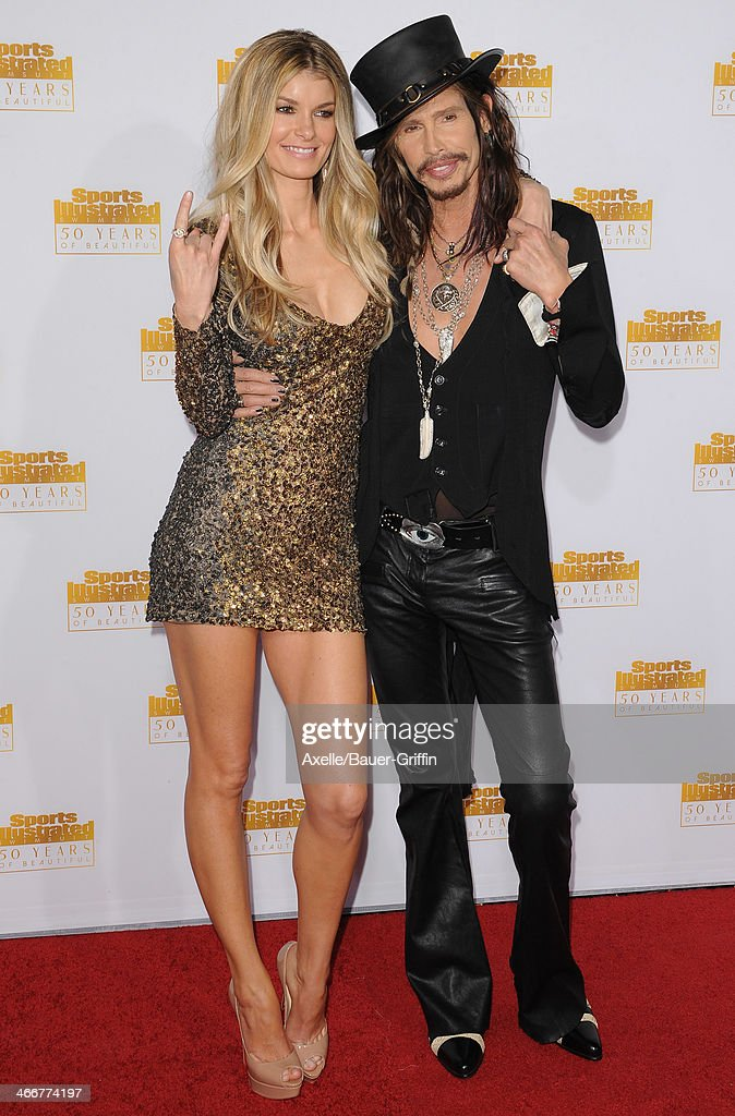 Actress/model Marisa Miller and singer Steven Tyler of Aerosmith arrive at NBC And Time Inc. Celebrate 50th Anniversary Of Sports Illustrated Swimsuit Issue at Dolby Theatre on January 14, 2014 in Hollywood, California.