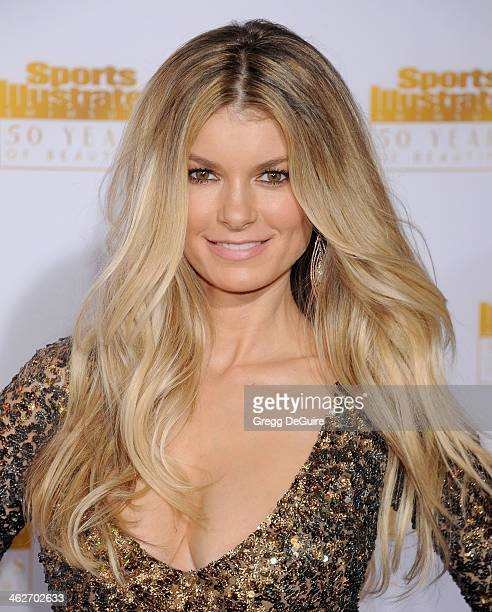 Actress/model Marisa Miller arrives at the 50th Anniversary Celebration Of Sports Illustrated Swimsuit Issue at Dolby Theatre on January 14 2014 in...