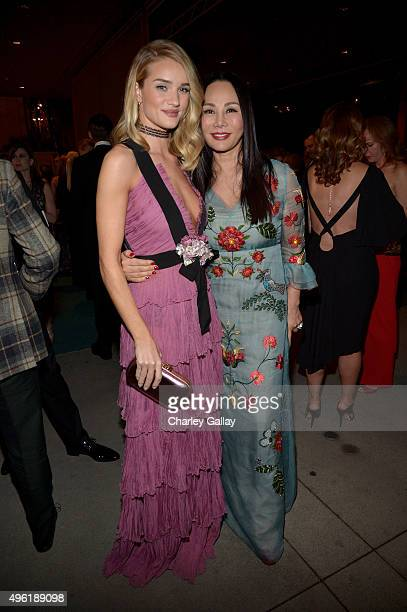 Actress/model Rosie HuntingtonWhiteley wearing Gucci and Art Film Gala cochair and LACMA Trustee Eva Chow wearing Gucci attend LACMA 2015 ArtFilm...