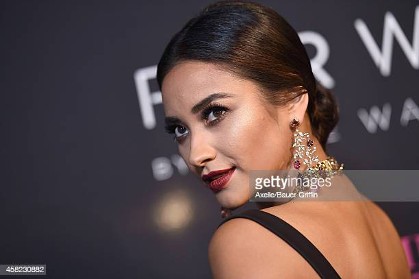 Actress/model Shay Mitchell arrives at the 10th Annual Pink Party held at Santa Monica Airport on October 18 2014 in Santa Monica California