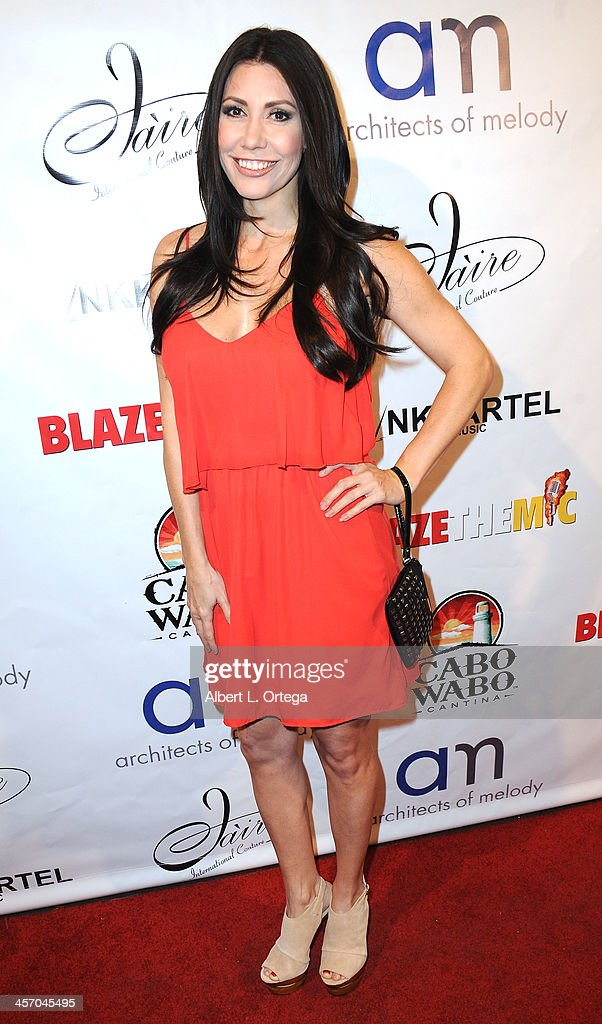 Actress/model Tawny Amber Young attends Britticares Toy Drive with a benefit concert by G Tom Mac & Many Of Odd Nature in conjunction with publicist Michael Arnoldi's Birthday held at Cabo Wabo Cantina on December 15, 2013 in Hollywood, California.