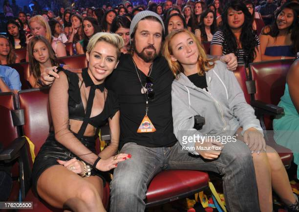 Actress/musician Miley Cyrus musician Billy Ray Cyrus and actress Noah Cyrus attend the 2013 Teen Choice Awards at Gibson Amphitheatre on August 11...
