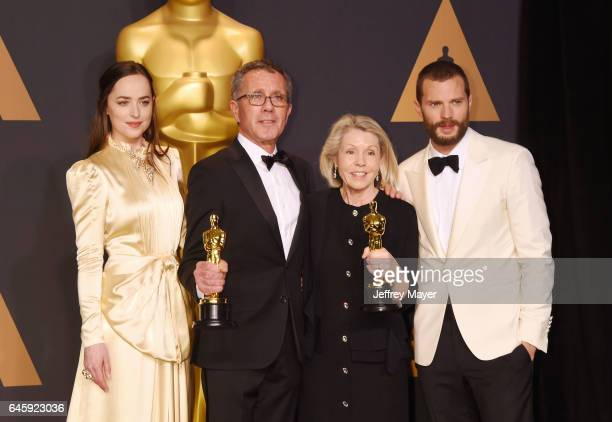 Actresspresenter Dakota Johnson production designer David Wasco set decorator Sandy ReynoldsWasco winners of the award for Production Design for 'La...