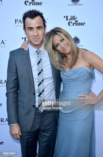 Actress/Producer Jennifer Aniston and actor Justin Theroux attend the 'Life of Crime' cocktail reception presented by PANDORA Jewelry at Hudson...