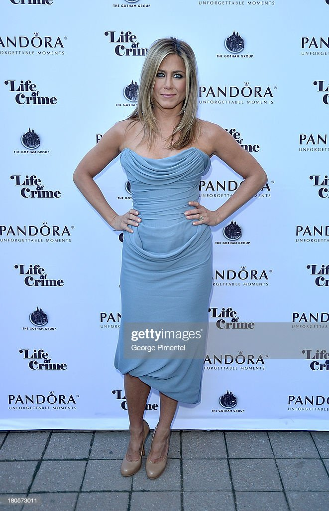 Actress/Producer <a gi-track='captionPersonalityLinkClicked' href=/galleries/search?phrase=Jennifer+Aniston&family=editorial&specificpeople=202048 ng-click='$event.stopPropagation()'>Jennifer Aniston</a> (wearing Vivienne Westwood gown) attends the 'Life of Crime' cocktail reception presented by PANDORA Jewelry at Hudson Kitchen during the 2013 Toronto International Film Festival on September 14, 2013 in Toronto, Canada.