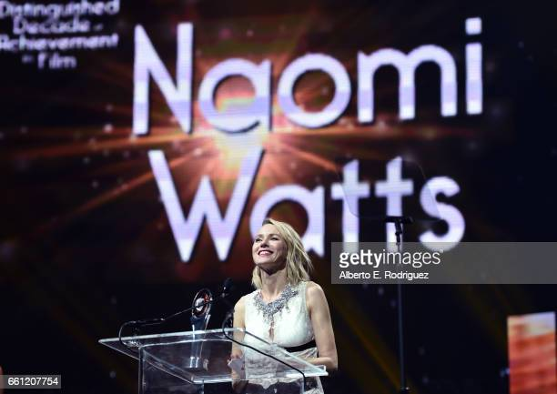 Actress/producer Naomi Watts accepts the Distinguished Decade of Achievement in Film Award onstage during the CinemaCon Big Screen Achievement Awards...