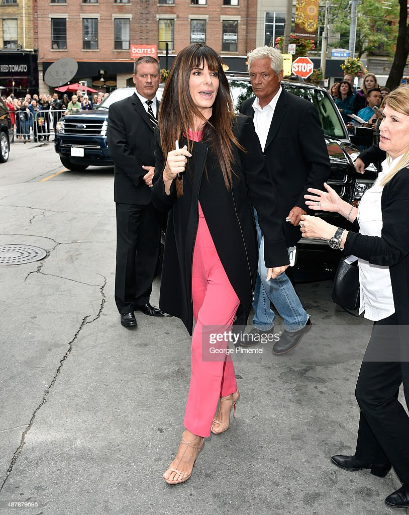Actress/producer Sandra Bullock walks to fans after the 'Our Brand Is Crisis' press conference at the 2015 Toronto International Film Festival at TIFF Bell Lightbox on September 12, 2015 in Toronto, Canada.