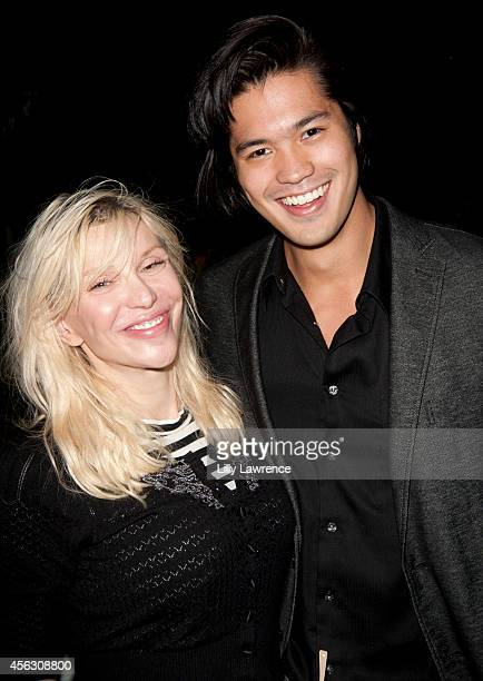 Actress/Recording artist Courtney Love and actor Ross Butler attend 2014 SMWLA Social 25 Party at 800MAIN on September 22 2014 in Venice California