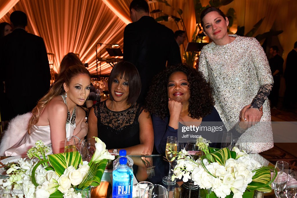 Actress/recording artist Jennifer Lopez, TV personality Gayle King, producer/actress Oprah Winfrey, and actress Marion Cotillard attend The Weinstein Company's Academy Awards Nominees Dinner in partnership with Chopard, DeLeon Tequila, FIJI Water and MAC Cosmetics on February 21, 2015 in Los Angeles, California.