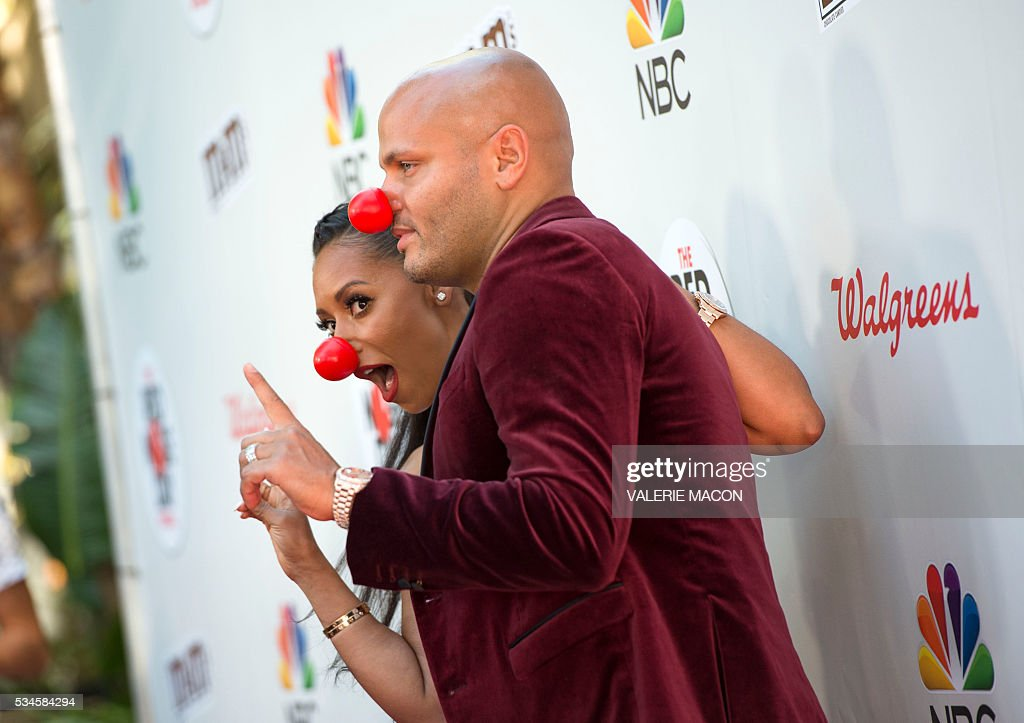 Actress/recording artist Mel B. (L) and producer Stephen Belafonte attend the 2nd Red Nose Day Special on NBC, in Universal Studios, California, on May 26, 2016. / AFP / VALERIE