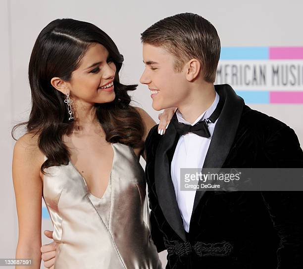 Actress/recording artist Selena Gomez and recording artist Justin Bieber arrive at the 2011 American Music Awards at Nokia Theatre LA Live on...