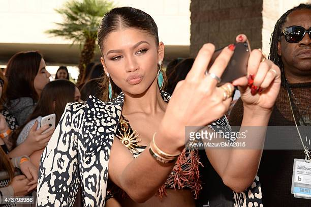 Actress/recording artist Zendaya poses for a selfie photo at the 2015 Billboard Music Awards at MGM Grand Garden Arena on May 17 2015 in Las Vegas...