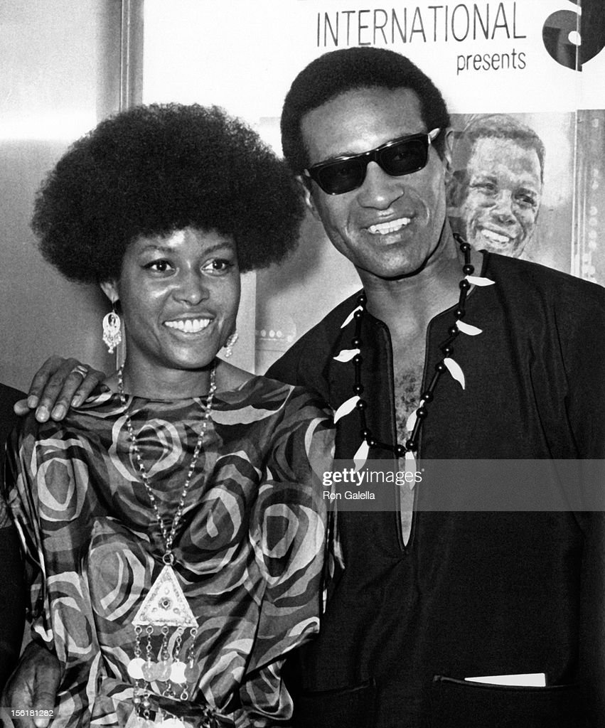Actress/singer Abbey Lincoln and musician Max Roach attend the premiere of 'For Love Of Ivy' on July 16, 1968 at Loew's Tower East Theater in New York City.