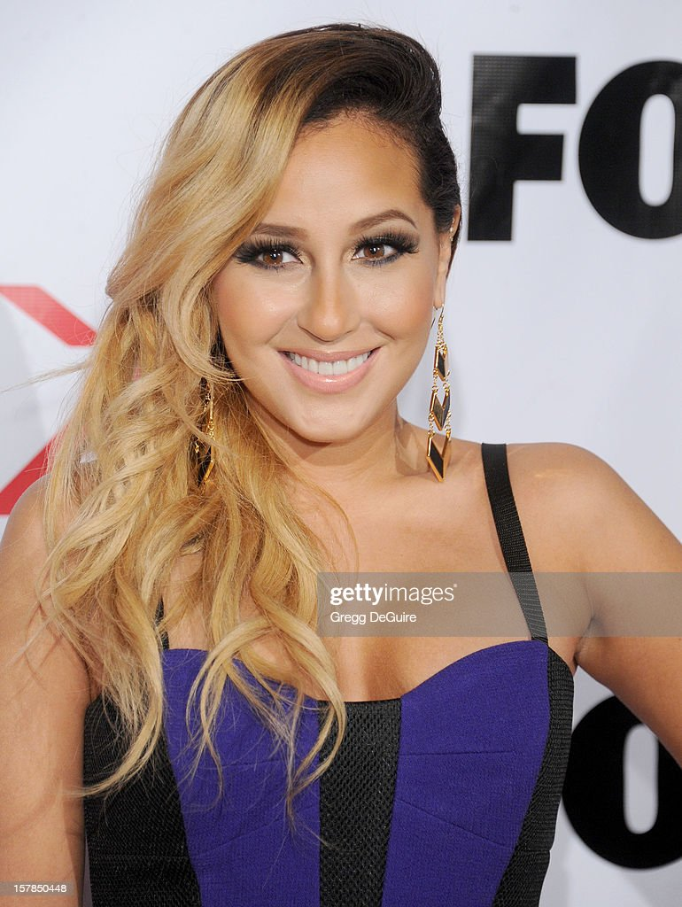 Actress/singer Adrienne Bailon arrives at FOX's 'The X Factor' viewing party at Mixology101 & Planet Dailies on December 6, 2012 in Los Angeles, California.