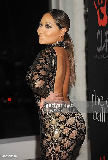 Actress/singer Adrienne Bailon arrives at Rihanna's First Annual Diamond Ball at The Vineyard on December 11 2014 in Beverly Hills California