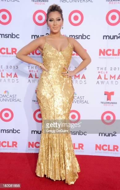 Actress/singer Adrienne Bailon arrives at the 2013 NCLA ALMA Awards at Pasadena Civic Auditorium on September 27 2013 in Pasadena California