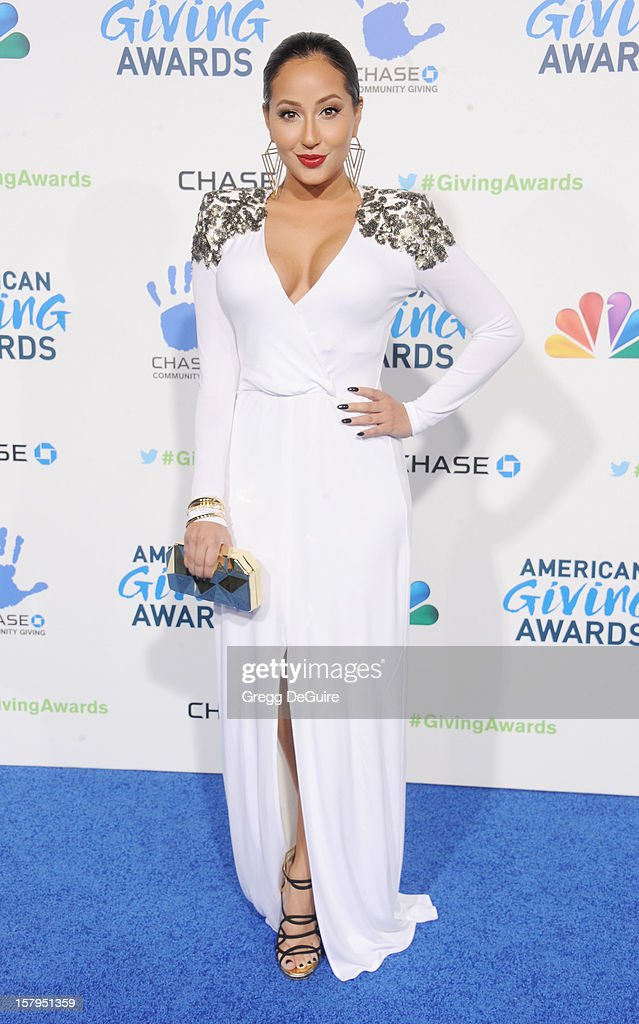 Actress/singer <a gi-track='captionPersonalityLinkClicked' href=/galleries/search?phrase=Adrienne+Bailon&family=editorial&specificpeople=540286 ng-click='$event.stopPropagation()'>Adrienne Bailon</a> arrives at the 2nd Annual American Giving Awards at the Pasadena Civic Auditorium on December 7, 2012 in Pasadena, California.