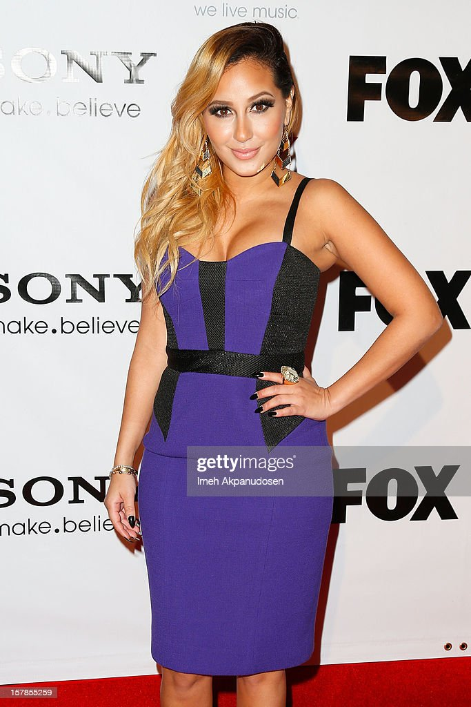 Actress/singer Adrienne Bailon attends Fox's 'The X Factor' viewing party at Mixology101 & Planet Dailies on December 6, 2012 in Los Angeles, California.