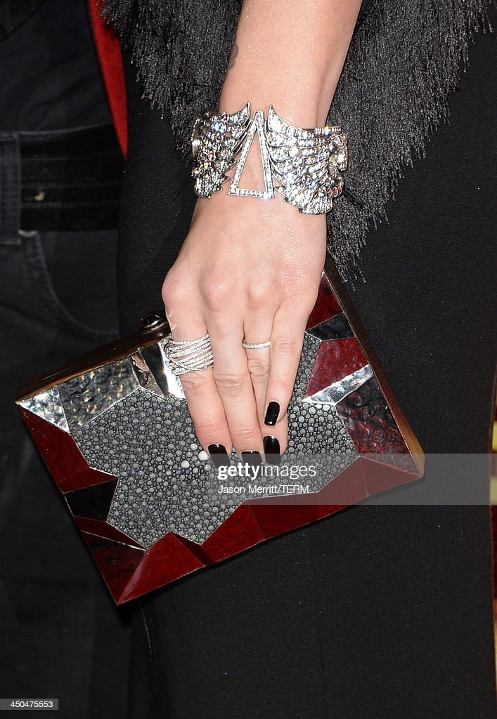 Actress/singer Ashlee Simpson (handbag detail) arrives at the premiere of Lionsgate's 'The Hunger Games: Catching Fire' at Nokia Theatre L.A. Live on November 18, 2013 in Los Angeles, California.