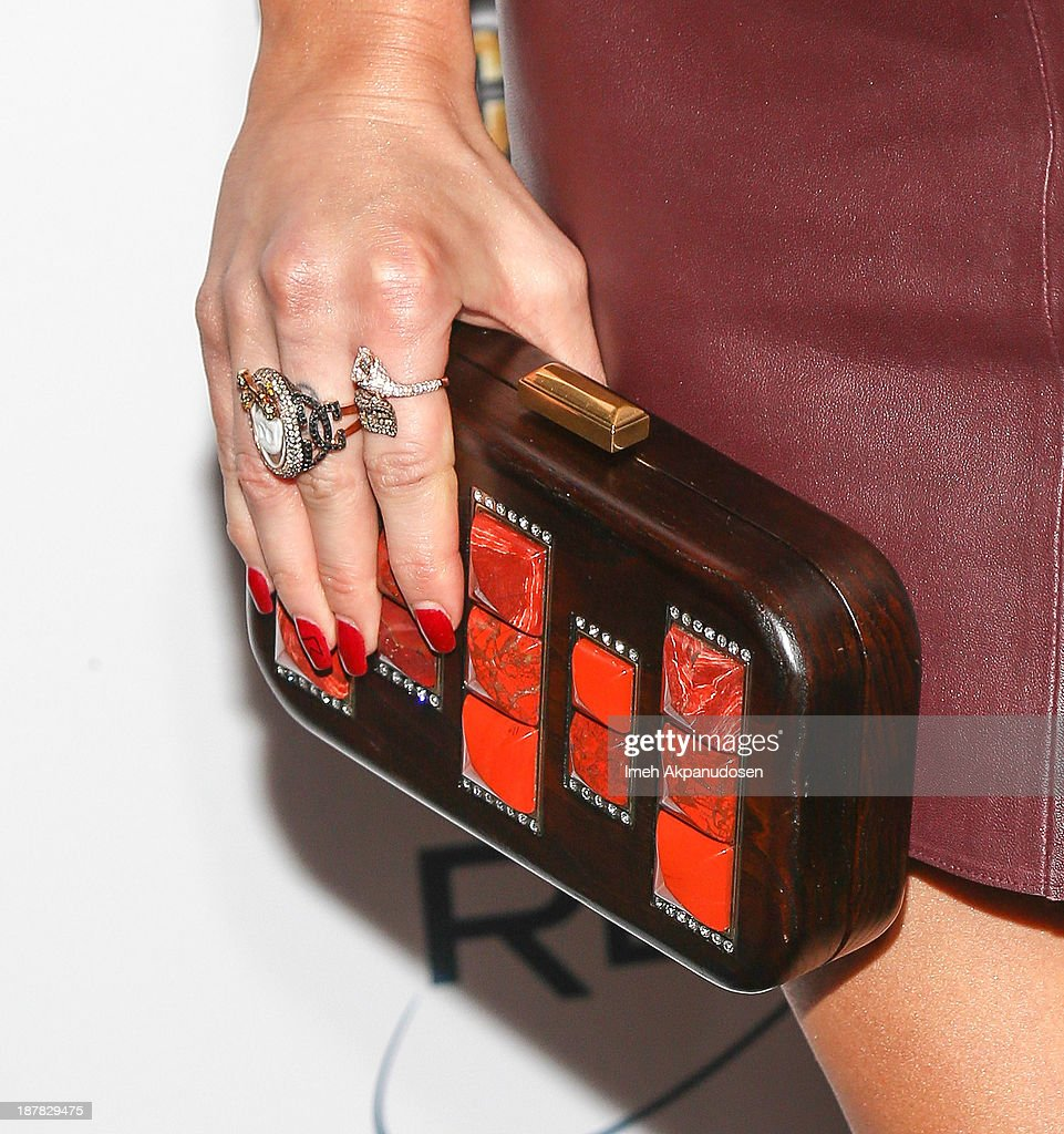 Actress/singer Ashlee Simpson (clutch and ring detail) attends the BandFuse: Rock Legends video game launch event at House of Blues Sunset Strip on November 12, 2013 in West Hollywood, California.