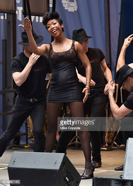 Actress/singer Brandy Norwood performs at the #StarsInTheAlley Outdoor Concert Featuring Darren Criss at Shubert Alley on May 27 2015 in New York City