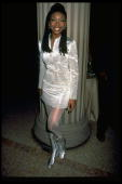 Actress/singer Brandy wearing silver Versace skirt suit w matching gogo boots at unident museum party