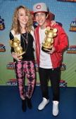 Actress/singer Bridgit Mendler and singer Austin Mahone pose backstage at the 2013 Radio Disney Music Awards at Nokia Theatre LA Live on April 27...