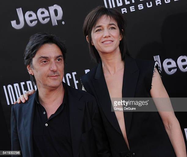 Actress/singer Charlotte Gainsbourg and actor Yvan Attal arrive at the premiere of 20th Century Fox's 'Independence Day Resurgence' at TCL Chinese...
