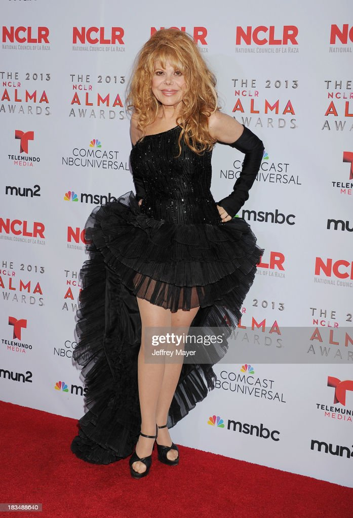 Actress/singer Charo poses in the press room at the 2013 NCLA ALMA Awards at Pasadena Civic Auditorium on September 27 2013 in Pasadena California
