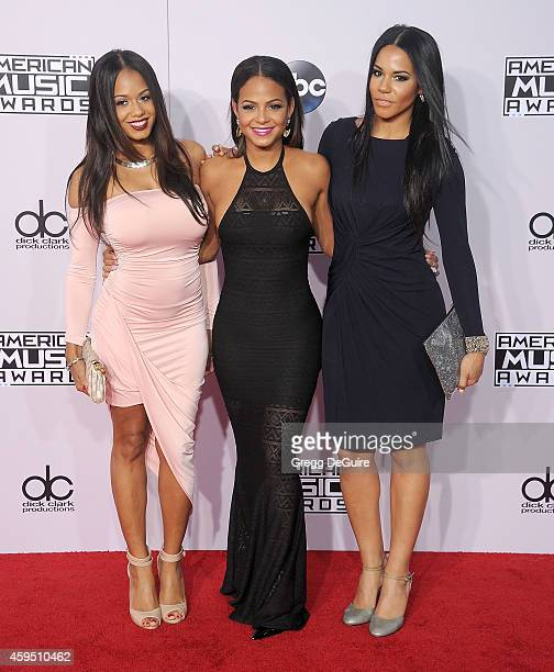 Actress/singer Christina Milian and sisters Danielle Flores and Elizabeth Flores arrive at the 2014 American Music Awards at Nokia Theatre LA Live on...