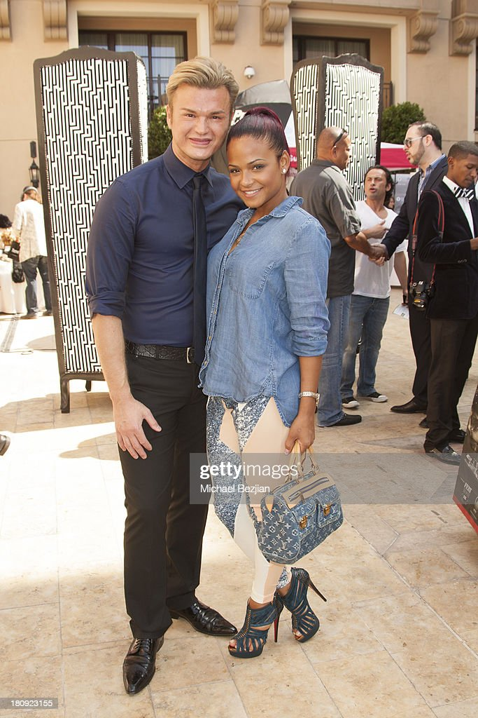 Actress/singer <a gi-track='captionPersonalityLinkClicked' href=/galleries/search?phrase=Christina+Milian&family=editorial&specificpeople=171274 ng-click='$event.stopPropagation()'>Christina Milian</a> (R) poses with Kim Vo, owner of Kim Vo Salon at Bellafortuna Luxury Gift Suite Presented By Feri on September 17, 2013 in Beverly Hills, California.
