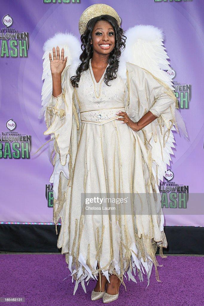 Actress/singer Coco Jones arrives at Hub Network's 1st annual Halloween bash at Barker Hangar on October 20, 2013 in Santa Monica, California.